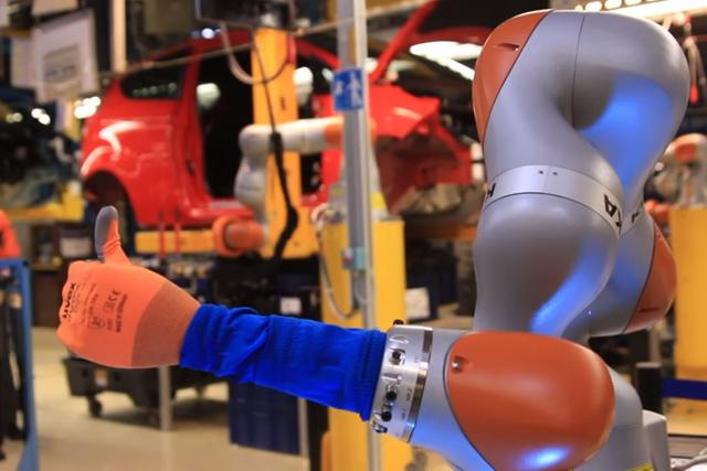 IMG - Co-bots collaborate with humans on Ford Fiesta assembly line | FourByThree